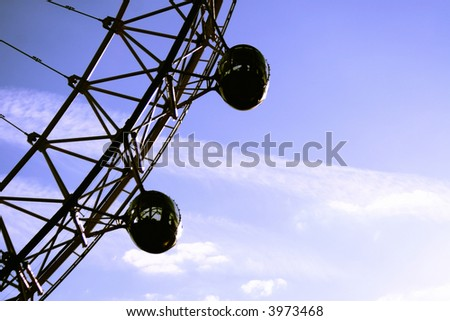 Silhouetted pods from Millenium wheel - stock photo