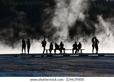 Silhouettes at Grand Prismatic Spring in Yellowstone National Park, Wyoming. - stock photo
