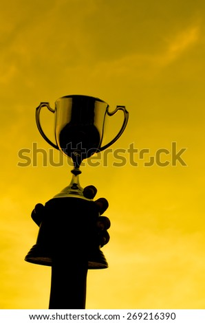 silhouettes boy with a cup and sun set natural light. - stock photo