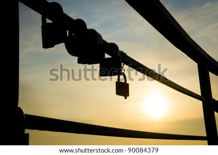 silhouettes hanging locks at sunset