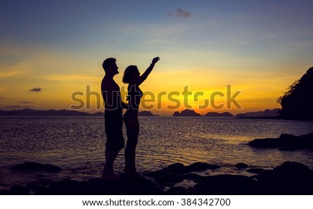 Silhouettes loving couple at sunset on the Philippine Islands
