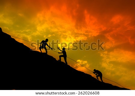 Silhouettes man and effort of climbing. - stock photo