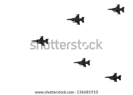 Silhouettes of armed fighter jets isolated on a white background - stock photo