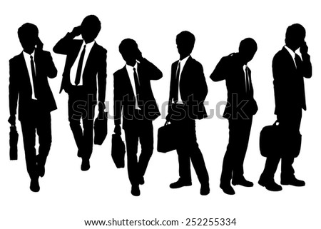 Silhouettes of Business men Walking and speaking mobile phone