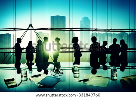 Silhouettes of Business People Brainstorming Meeting Concept