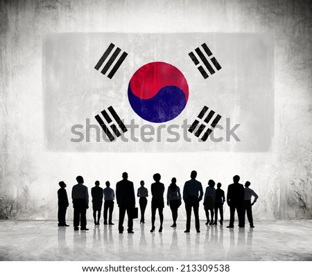 Silhouettes of Business People Looking at the South Korean Flag - stock photo