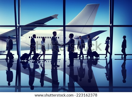 Silhouettes of Business People on an Airport - stock photo