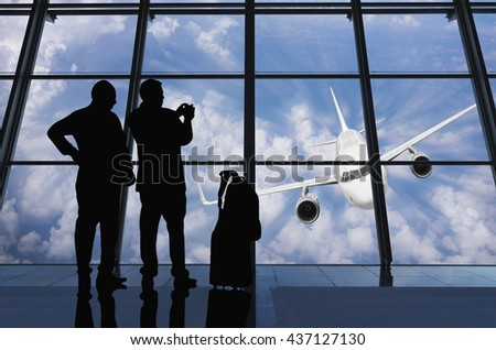 Silhouettes Of Business People Waiting In Airport Terminal.