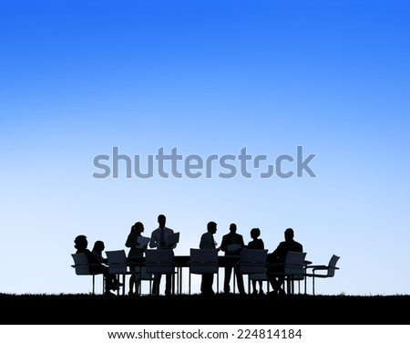 Silhouettes of Business People Working Outdoors - stock photo