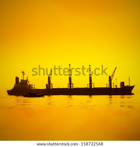 Silhouettes of Cargo Ship