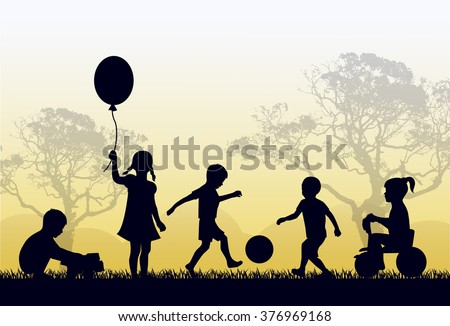 Silhouettes of children playing outside in the grass and trees - stock photo