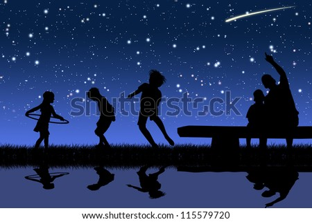 silhouettes of children playing sports at night - stock photo
