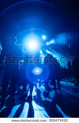 silhouettes of concert crowd waiting for the next band - stock photo