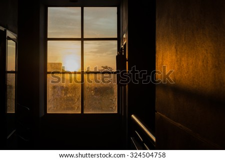 Silhouettes of Dirty glass window with sunset background, Concept for Halloween house or castle
