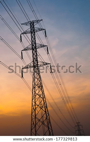 silhouettes of electricity post  with sunset sky background