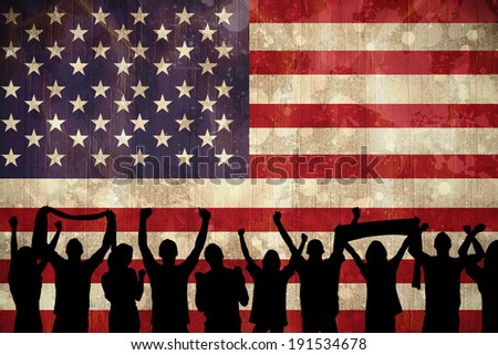 Silhouettes of football supporters against usa flag in grunge effect