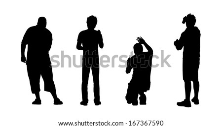 silhouettes of four young men drawing graffiti on the wall in different postures, view from behind - stock photo