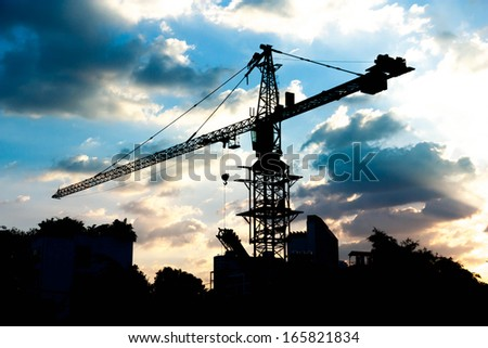 silhouettes of Industrial construction crane - stock photo