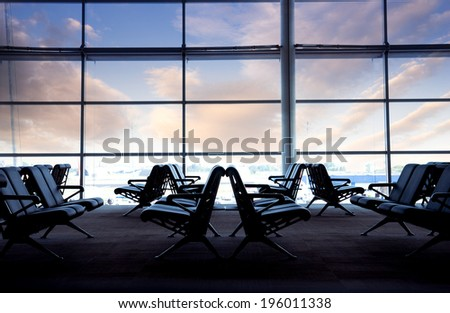 Silhouettes of interior seat to wait and transfer at airport  - stock photo