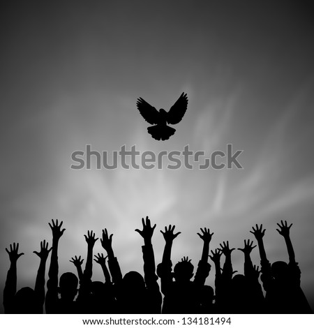 Silhouettes of Large group of raising hands and flying dove