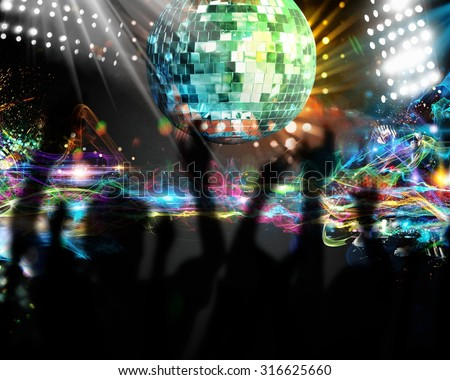 Silhouettes of many people dancing in nightclub - stock photo