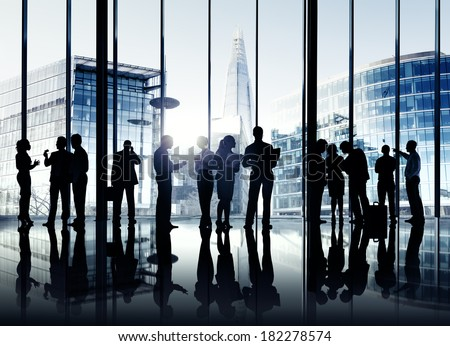 Silhouettes Of Multi-Ethnic Group Of Business People In Office - stock photo