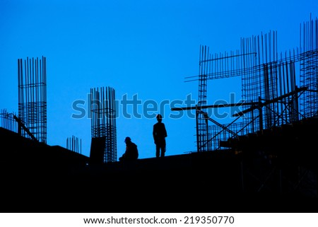Silhouettes of people and construction