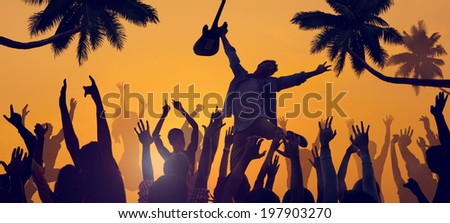 Silhouettes of People Enjoying a Concert on the Beach