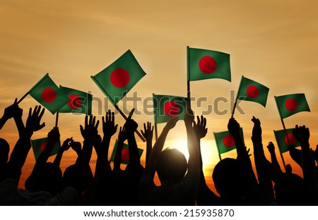 Silhouettes of People Holding Flag of Bangladesh - stock photo