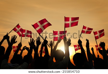 Silhouettes of People Holding the Flag of Denmark
