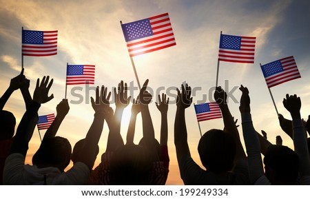 Silhouettes of People Holding the Flag of USA - stock photo
