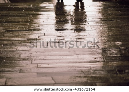 Silhouettes of people in the rain  Sett on