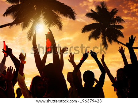 Silhouettes of People Partying on the Beach