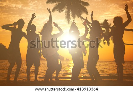 Silhouettes of People Partying Outdoors - stock photo
