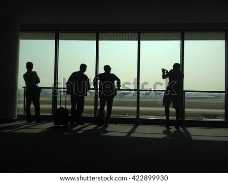 Silhouettes of people traveling at Airport Passenger - stock photo