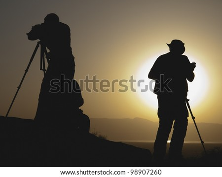 Silhouettes of photographers