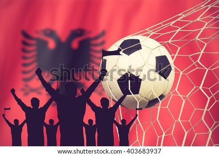 silhouettes of Soccer fans with flag of Albania  .Cheer Concept vintage color