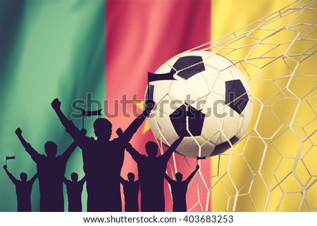 silhouettes of Soccer fans with flag of Cameroon .Cheer Concept vintage color