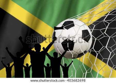 silhouettes of Soccer fans with flag of Jamaica .Cheer Concept - stock photo
