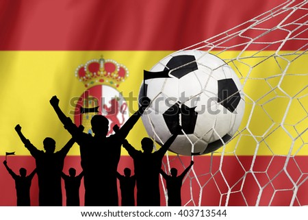 silhouettes of Soccer fans with flag of Spain .Cheer Concept