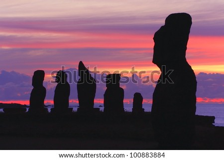 Silhouettes of Tahai Ceremonial Complex, an archaeological site on Rapa Nui (Easter Island, Isla de Pasqua) in Chilean Polynesia after sunset. - stock photo