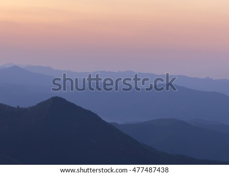 Silhouettes of the mountain hills after sunset. mountain cascade