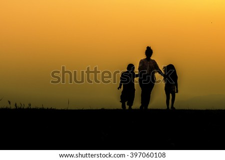 Silhouettes of the parents and children on a background of  even