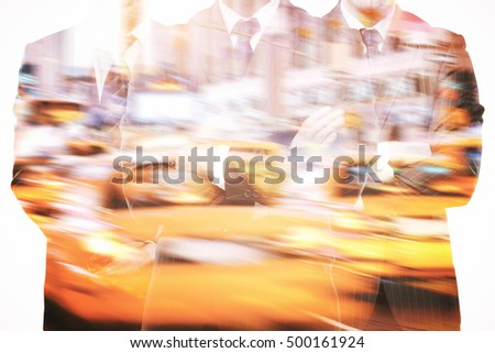 Silhouettes of three businessmen in suits and with folded arms on abstract night city in motion background. Double exposure. Teamwork, partnership and leadership concept