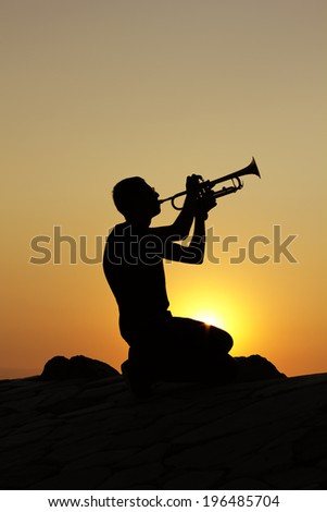 Silhouettes of trumpet player
