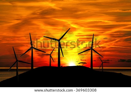 Silhouettes of Wind Turbines at Sunset / Six silhouettes of wind turbines in mountain with a beautiful sunset over the sea