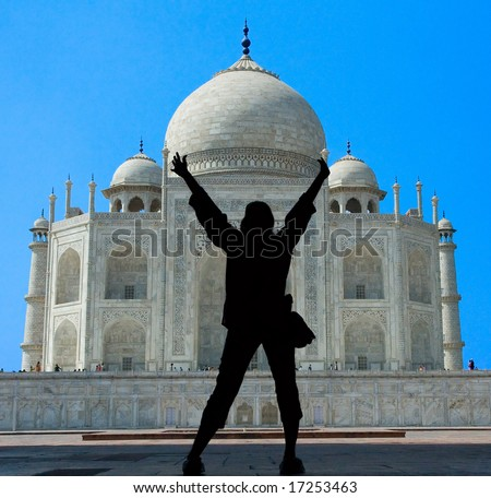 Silhouettes of woman under the arches at the Taj Mahal mausoleum - Agra, Uttar Pradesh, India - stock photo