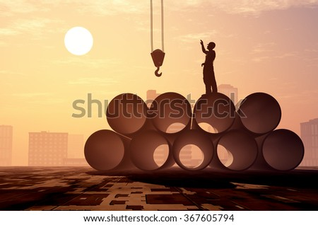Silhouettes of worker on the pipes. - stock photo