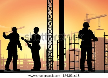 Silhouettes of workers against the background of the city.