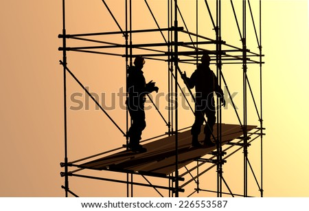 Silhouettes of workers on a background of the sky